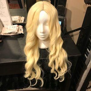 Blonde curled cap wig